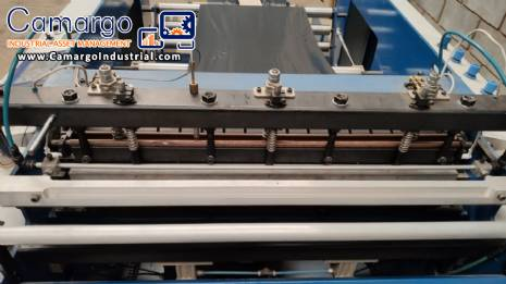 Complete line for manufacturing plastic bags and sacks