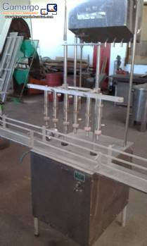 Linear filling machine with 6 stainless steel spouts Nocelli